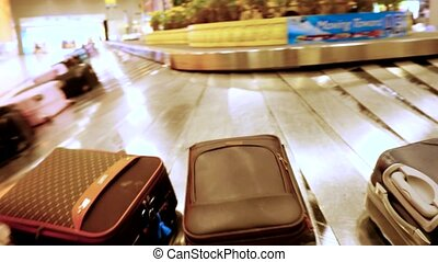 Luggage travels on a conveyor belt in the airport....