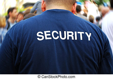 security man - security guard in front of blurred crowd