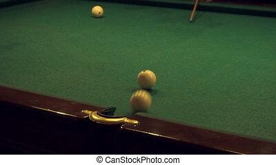 men play Russian Billiards in slow motion