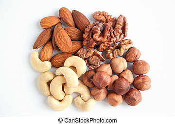 Four kind of the nutritious nuts. Isolated objects on white...