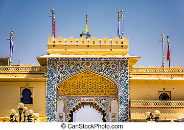 Golden fort wall with ornamented gate at Udaipur, India.