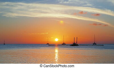 Dawn at the Caye Caulker Island - Sun going down at the...