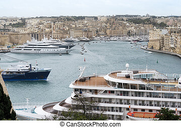 Cruise ship and yachts docked at the port of Malta