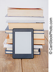 E-book reader on a stack of books