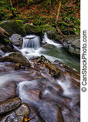 small cascade on the river among bouders - small cascades on...
