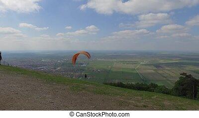 paraglide extreme sport - Paraglider sportman flies in the...