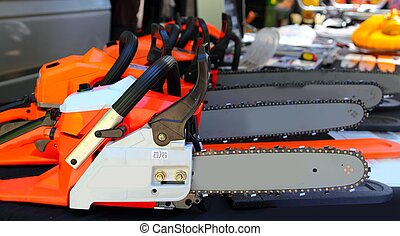 chain saw machines row perspective in market - chain saw...