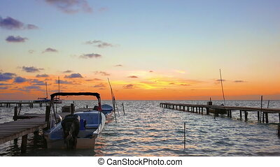 Calm Sunrise at Caye Caulker, Belize - Boat in between of...