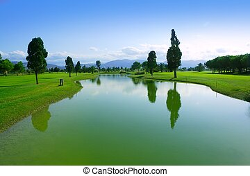 Golf course green grass field lake reflection - Golf course...