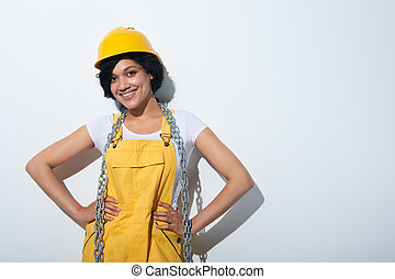 Happy smiling woman builder wearing yellow protect helmet