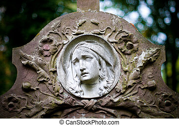 woman face on tombstone