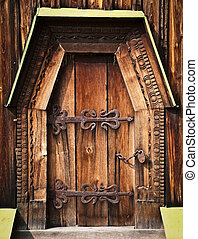 old wooden gate - old beautiful wooden gate with ornate iron...