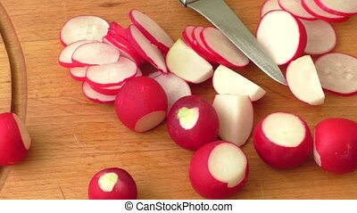 Slicing radish on a rustic wooden table