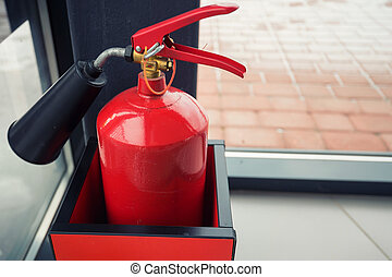 Red fire extinguisher - Close-up of red modern fire...