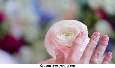 A girl is stroking a flower