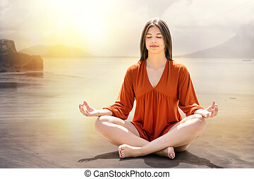 Young woman meditating at riverside. - Portrait of young...