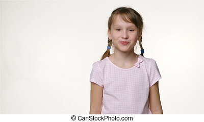 Little girl with two braids looking at camera smiling -...