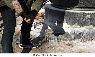 Sledge hammer blows of granite stones. 4K.
