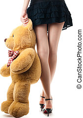 sexy girl with toy bear - woman wearing skirt and high...