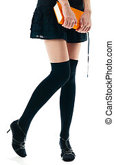 woman in skirt and stockings - view of the lower body part...