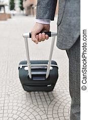 businessman pulling a trolley case