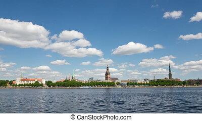 Latvia. Clouds move on the blue sky over Riga and Daugava...