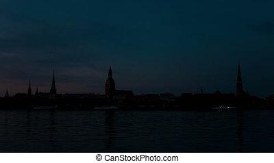 Latvia.Sunrise over Riga and Daugava river.Time lapse -...