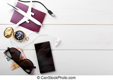 traveling concept - travel items on white wooden background with copy space