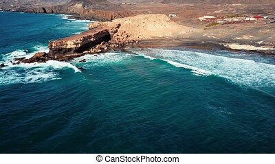 Flying over cliff in La Pared, Fuerteventura, Canary...
