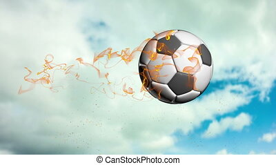 Soccer ball flies against a cloudy sky background - Soccer...