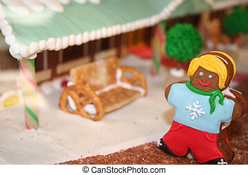 Holiday gingerbread girl on decorated street scene