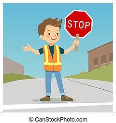 Little boy in crossing guard uniform in the street