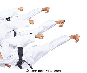 An athlete with a black belt is beating three high kick...