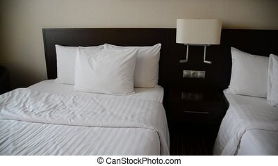 Small hotel room with two beds - A Small hotel room with two...