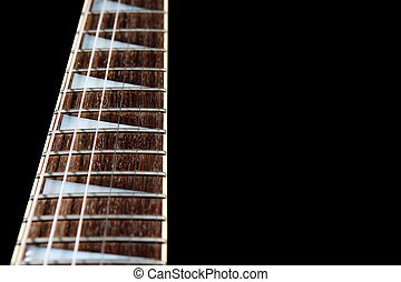A six string electric guitar neck isolated on a black...