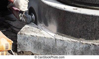 Mason grinder granite sawing. 4K. - Mason grinder granite...