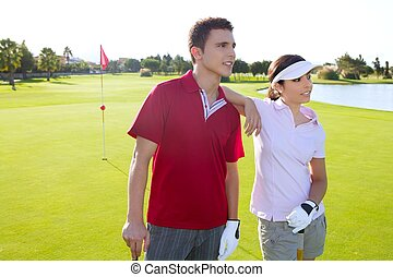 Golf course young players couple standing