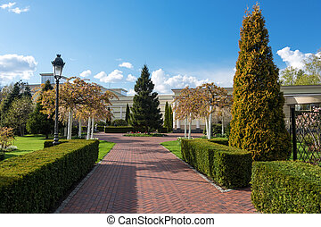 Garden with topiary landscape. Landscaping in the park.