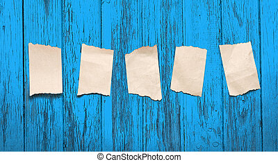 Scraps placed on the blue wooden background