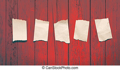 Scraps placed on the red wooden background