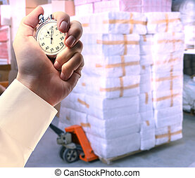 Paper products storehouse and stopwatch in hand