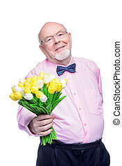 a gift to grandmother - Happy smiling old man gives a...