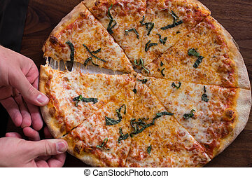 Brick Oven Pizza - Brick oven pizza topped with fresh basil...