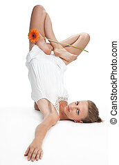 woman in yoga pose with flower