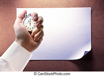 Blank sheet of paper and stopwatch in hand