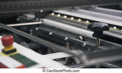 Pan shot of industrial printer working - Pan shot of an...