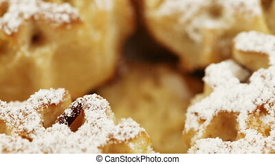 Dietary muffins with powdered sugar - Rotating a group of...