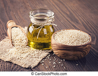 Sesame oil and seeds - Sesame oil in glass and seeds