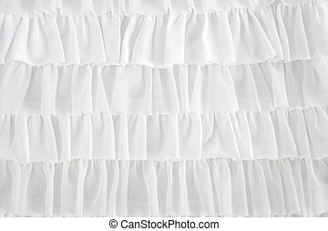 pleated skirt fabric fashion in white closeup detail macro