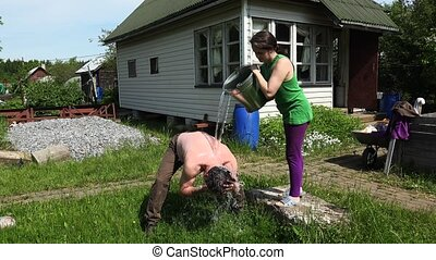 The girl pouring water from a bucket man. 4